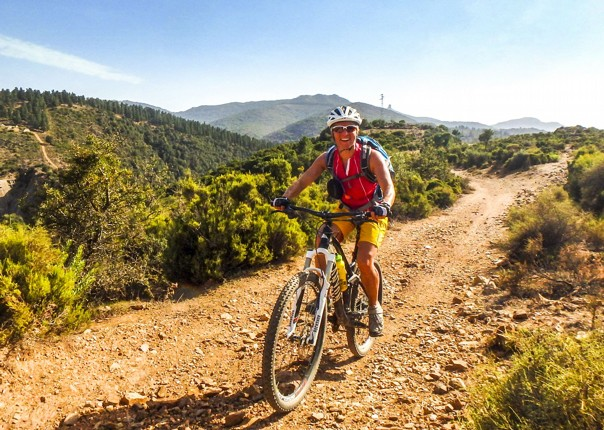 woman-mountain-biking-saddle-skedaddle-sardinia-italy.jpg