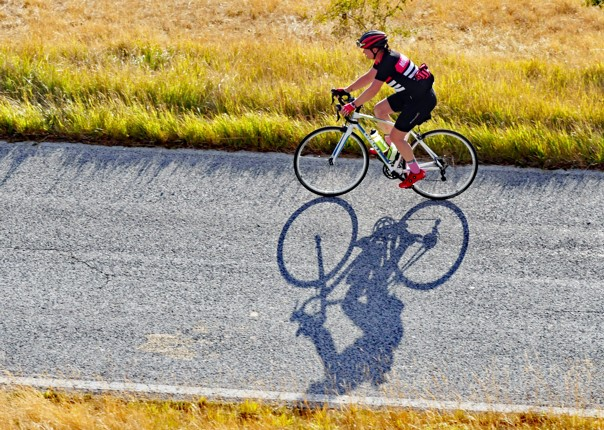 Tracey chasing her shadow - landscape.jpg - Italy - Grand Traverse - North to South - Road Cycling
