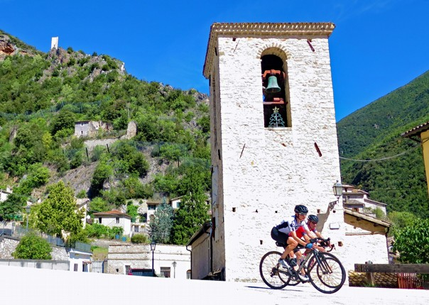 Phil and Fiona cornering Canon version.jpg - Italy - Grand Traverse - South to North (22 days) - Guided Road Cycling Holiday - Road Cycling
