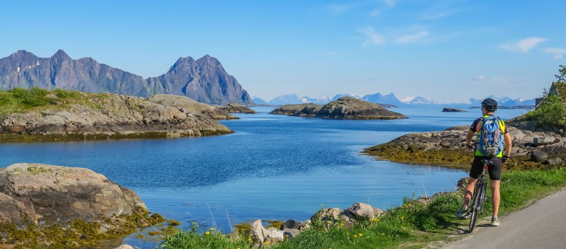 The Lofoten Islands are a narrow chain of islands boasting jagged peaks that sweep down to the sea leaving a narrow brim of coastal road with breathtaking views amid charming fishing villages. It's simply perfect for cycling!