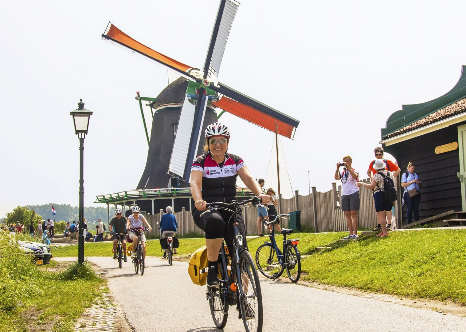 dutch-windmill-landscape-with-group-bike-leaders.jpg - Holland - Green Heart - Bike and Barge Holiday - Leisure Cycling