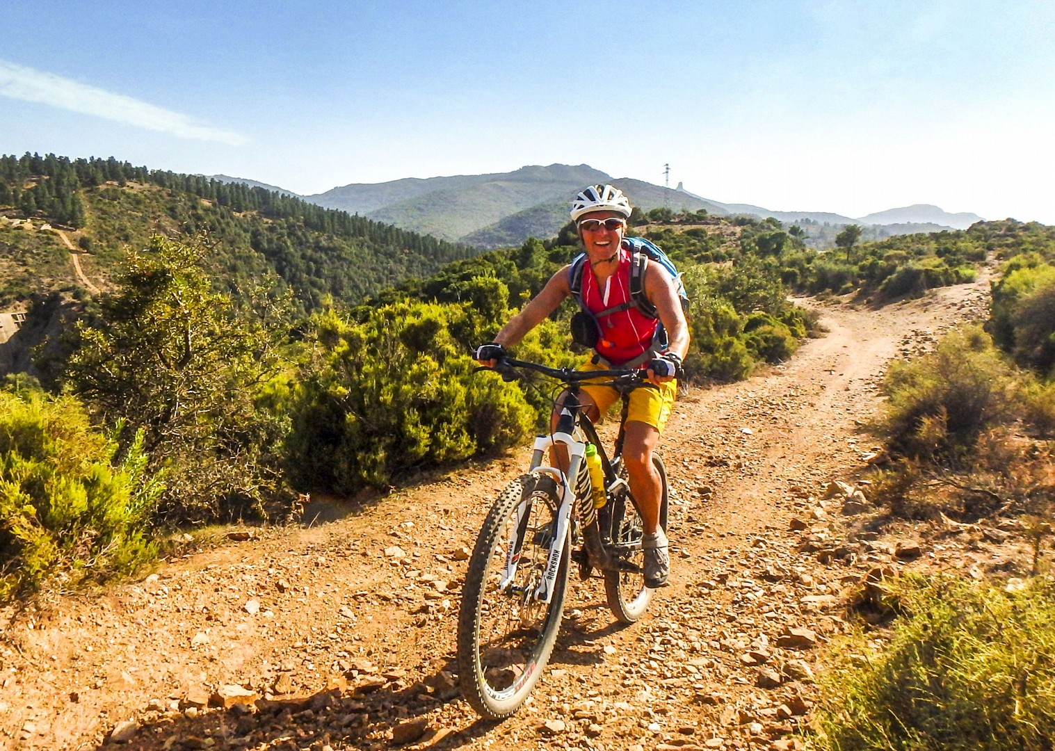 woman-mountain-biking-saddle-skedaddle-sardinia-italy.jpg - Italy - Sardinia - Coast to Coast - Self-Guided Mountain Bike Holiday - Mountain Biking