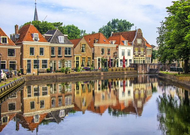 traditional-holland-and-belgium-houses-skedaddle-cycling-tour-boat.jpg